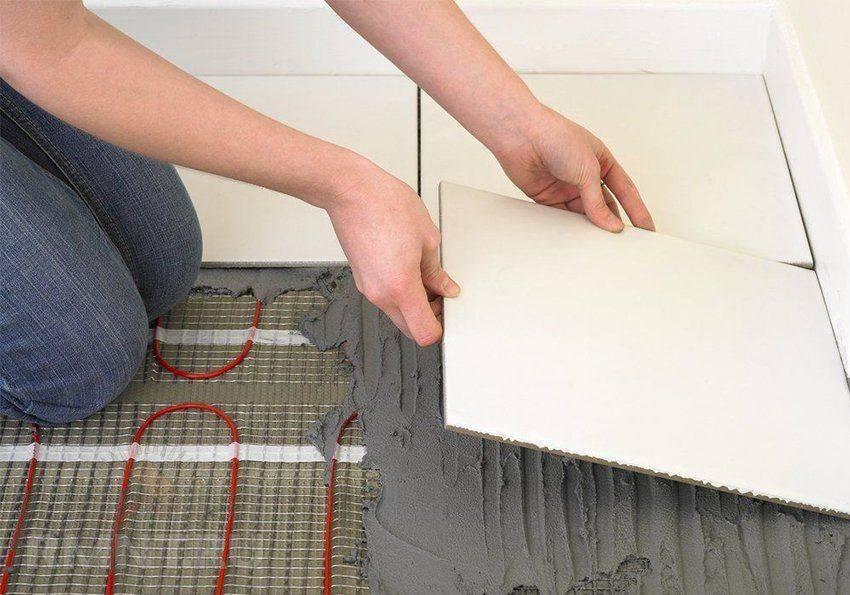Как сделать электрический теплый пол в ванной под плитку – виды и технология монтажа
