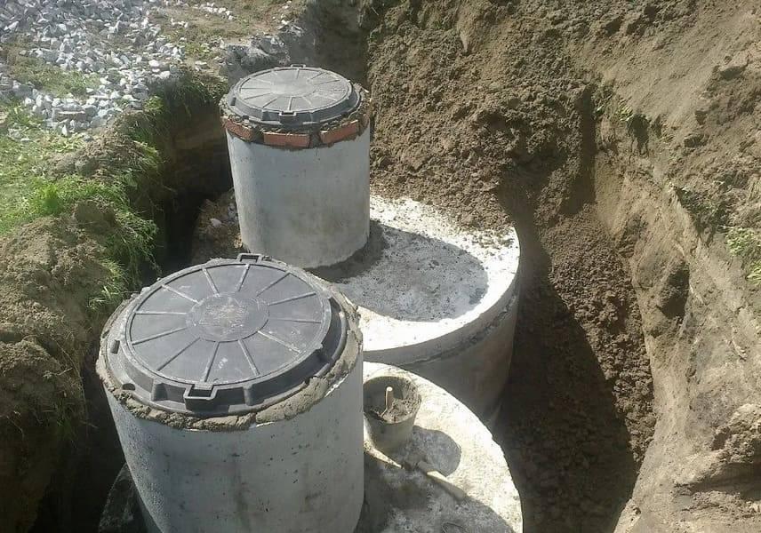 Септик из бетонных колец: виды, схема и этапы установки своими руками
