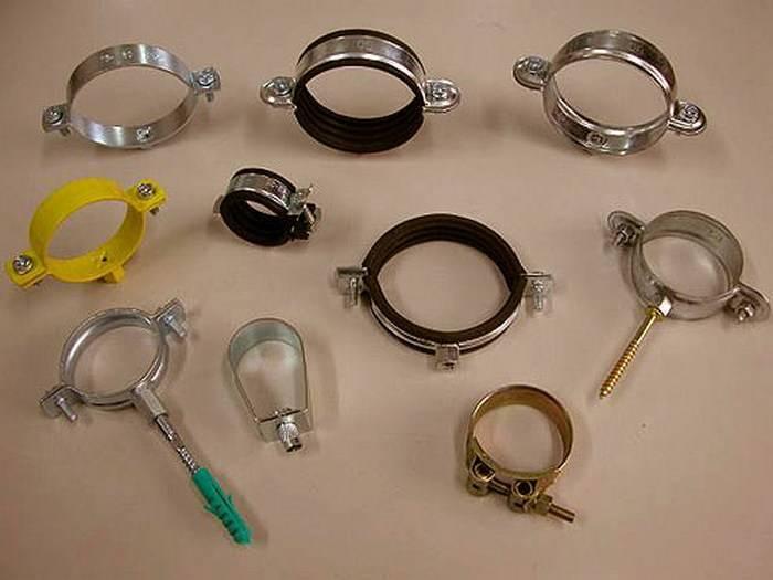 Металлические хомуты (35 фото): обжимные стальные хомуты-стяжки и железные хомуты с гайкой и шурупом, другие модели, их размеры