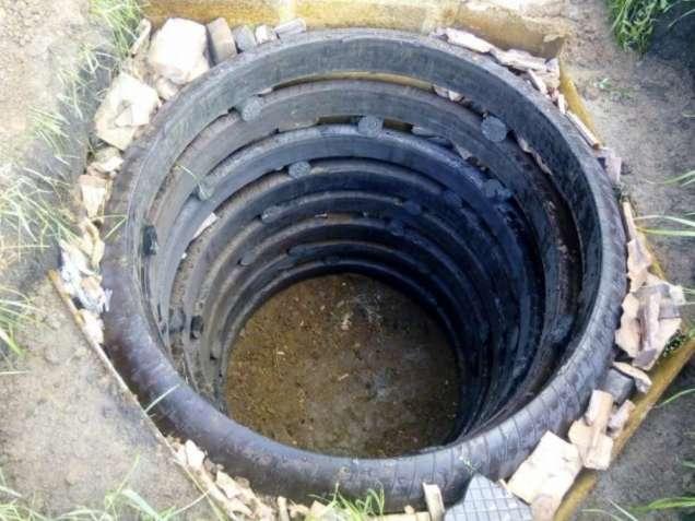 Как сооружается выгребная яма из покрышек своими руками